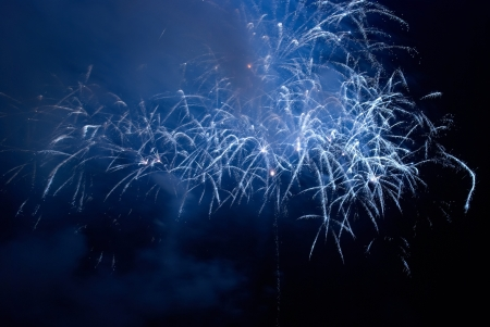 Blue colorful holiday fireworks on the black sky background. Stock Photo - 15408068