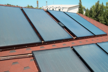gelio: Solar water heating panels on the red roof. Gelio system Stock Photo