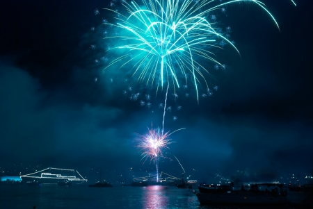 Colorful fireworks on the black sky background photo