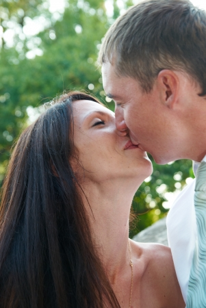 Beautiful wedding couple- bride and groom. Just married. Wedding kiss. photo