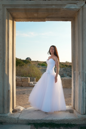 Beautiful bride in the white dress photo