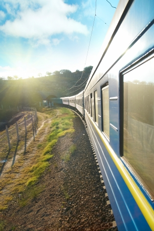 Motion train and blue wagon. Urban transportation 스톡 콘텐츠