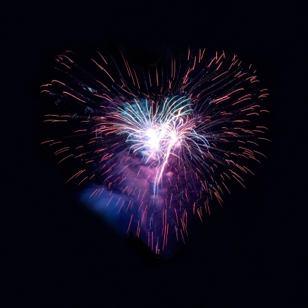 Heart fireworks on the black sky background photo