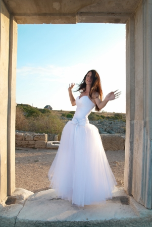 Beautiful bride in the white dress The greece ancient door photo