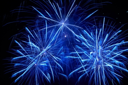 Blue colorful fireworks on the black sky background Stock Photo - 16392165