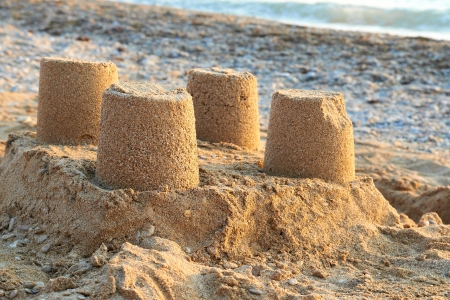 sand art: Towers from sand- castle on the beach Stock Photo