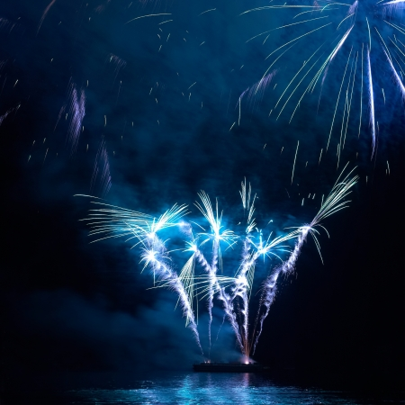 Blue colorful holiday fireworks on the black sky background  photo