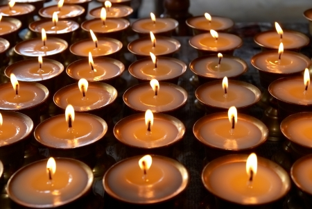 prayer candles: Rows of candles in the indian temple
