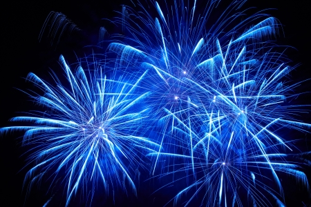 fireworks display: Blue colorful fireworks on the black sky background Stock Photo