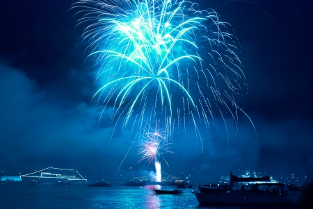 Colorful blue fireworks on the black sky background photo