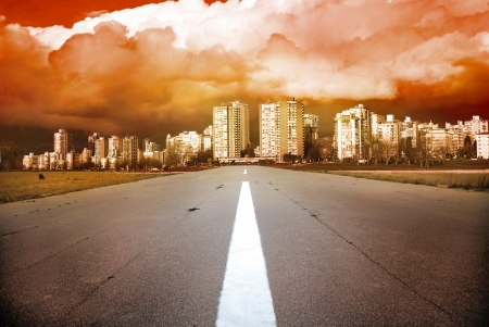 Empty highway- road heading to the city with dramatic dark stormy clouds   Stock Photo - 16859186