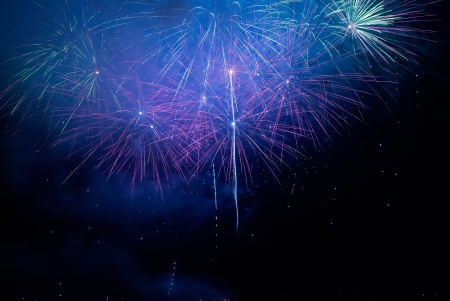 Colorful holiday fireworks on the black sky background. Stock Photo - 17452411