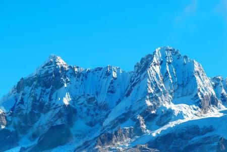 himalayas: Top of High mountains, covered by snow. Kangchenjunga, India.