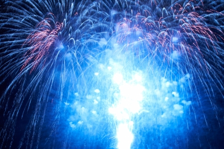 Blue colorful fireworks on the black sky background 스톡 콘텐츠