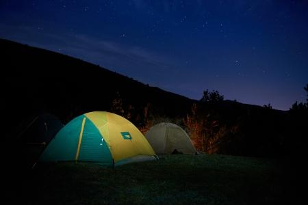 camping tent: Illuminated yellow camping tent under stars at night