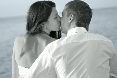 Beautiful wedding couple- bride and groom kissing at the beach. Just married Stock Photo - 17662537