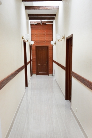Light hall with marble flour and the door at the end oh corridor photo