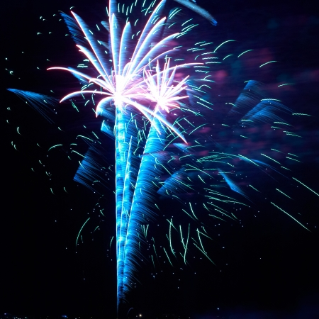 Blue and red colorful holiday fireworks on the black sky background. Stock Photo - 18599991