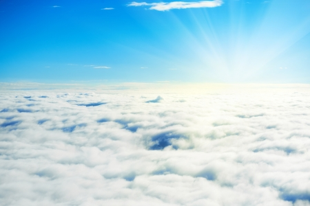 skyscape: Blue sky and clouds. Plane view above the earth, can be used for background