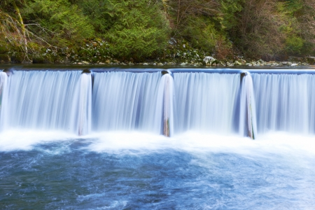 water conservation: Waterfall cascade streaming down in the green forest Stock Photo