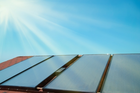 Solar water heating panels on the red roof. Gelio system 스톡 콘텐츠