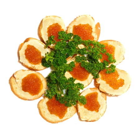 Tartlets with red caviar isolated on white background  photo