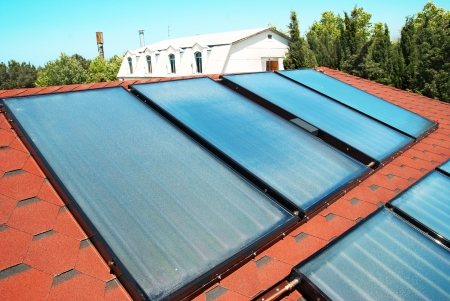 gelio: Solar water heating panels on the red roof  Gelio system