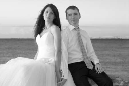 Beautiful wedding couple- bride and groom at the beach  Just married  Black and white photo
