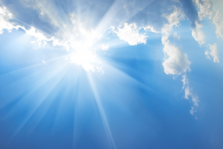 Beautiful blue sky with sunbeams and clouds  Sun rays  Stock Photo