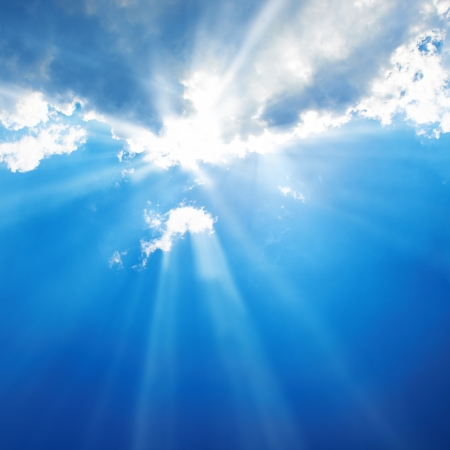 Beautiful blue sky with sunbeams and clouds  Sun rays  photo