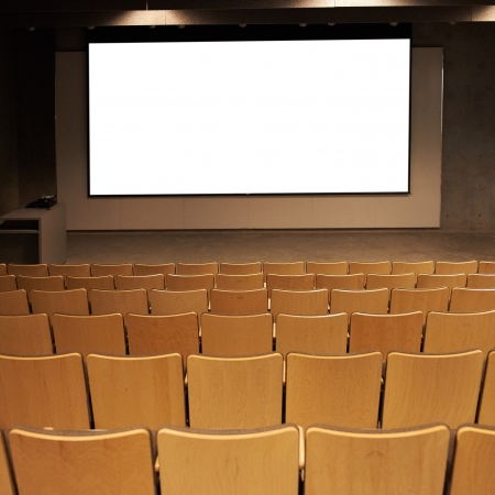 cinema screen: Empty cinema with white isolated screen and brown chairs