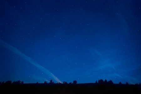 Blue dark night sky with many stars  Space background photo