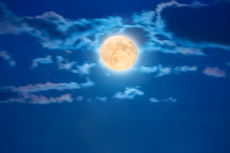 Big shiny moon on the blue sky with clouds photo