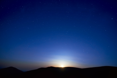 Blue dark night sky with many stars  Moon rising  Space background