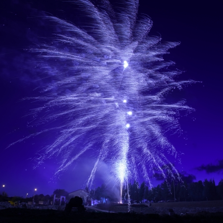 Blue colorful fireworks on night sky  Stock Photo - 25170862