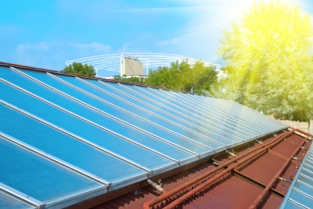 roof light: Solar water heating system on the red roof  Gelio panels  Stock Photo