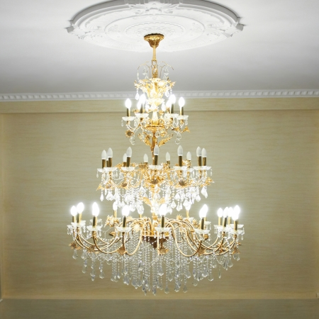 Beautiful crystal ancient chandelier in a hall  Lamp with soft yellow light photo