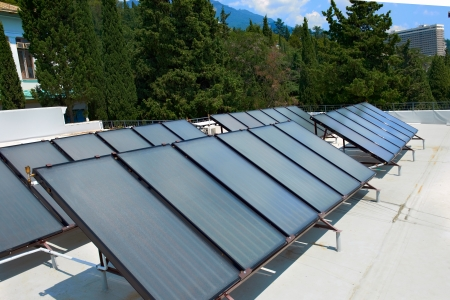 Solar water heating system on the red roof  Gelio panels  스톡 콘텐츠
