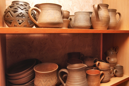 clay craft: Many handmade old clay pots on the shelf