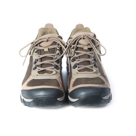 Pair of brown trainers on white isolated background photo