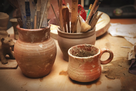 crock pot: Handmade old clay pots with other stuff on the table Stock Photo