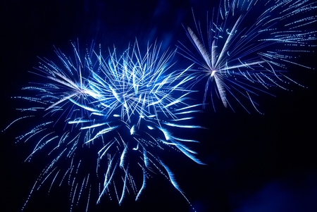 blu sky: Colorful fireworks on the black sky background Stock Photo