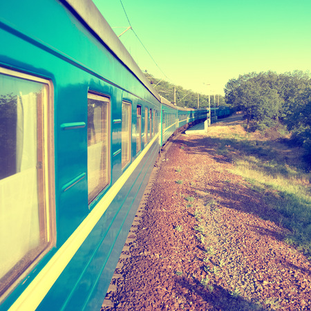 Motion train and blue wagon  Urban transportation  Modern colorization photo