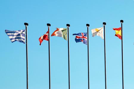 Row of european flags against blue sky background photo