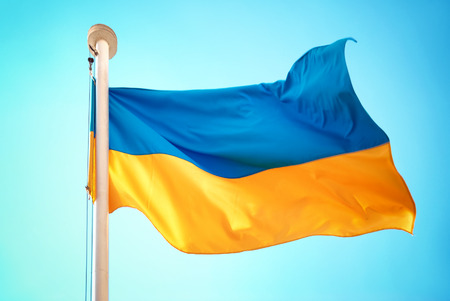 waft: Ukrainian blue and yellow flag on the sky background