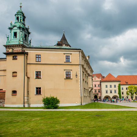 polska monument: Wawel Cathedral in Krakow, Poland  Green lawn agaist the castle