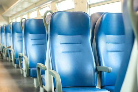 Empty blue seats in european modern train photo