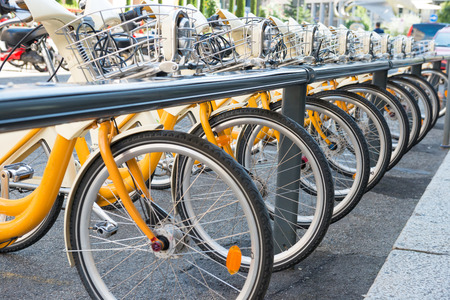 bycicle: Yellow bikes parking on the street in Europe