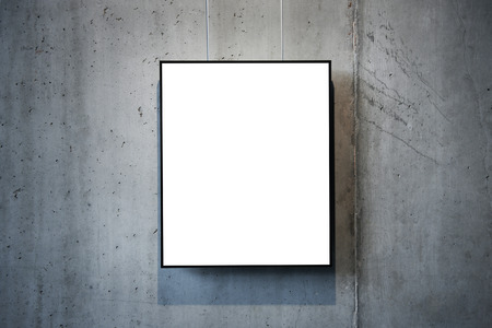 Empty white isolated frame on the wall photo