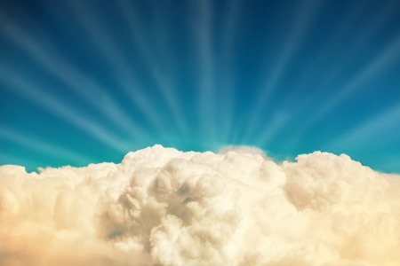 Blue clouds and sky. Natural background with sun beams photo
